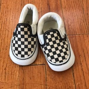 Black and white checkered Vans.